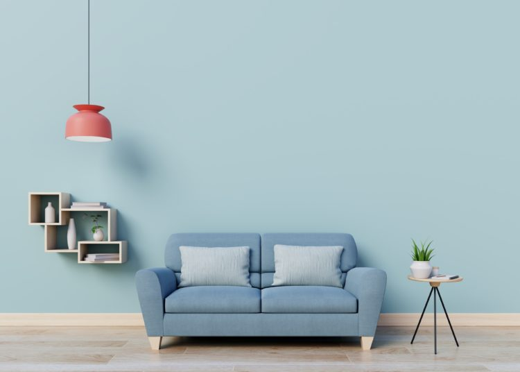 Blue sofa on a blue wall