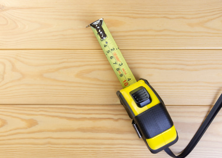 Tape Measures On Wooden Floor