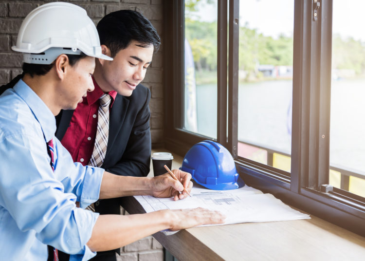 engineer architect work desk with paper and equipment business concept