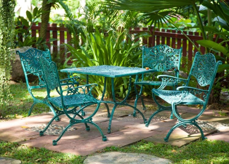 Chairs and tables, located in the garden made ​​from metal to sit in the garden.