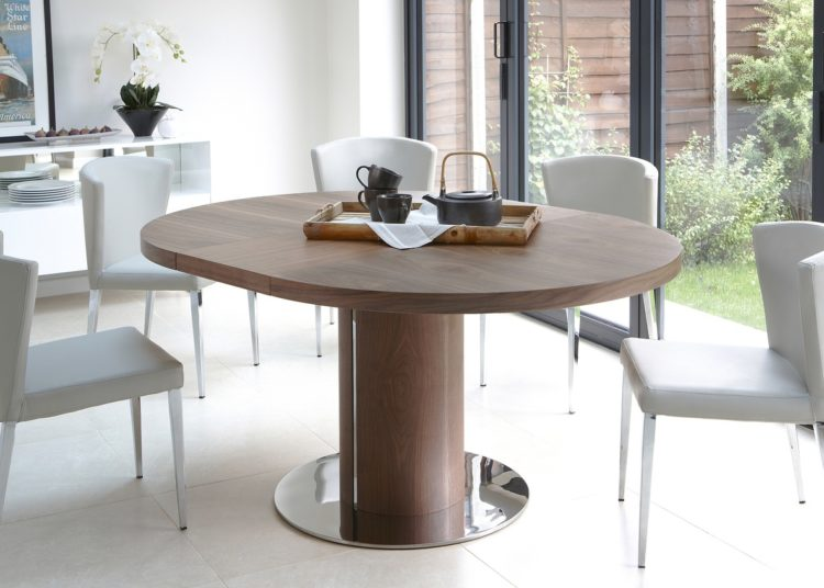 Round walnut dining table with chairs