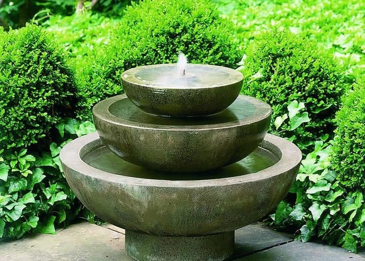 Beautiful fountain in the garden, summer time