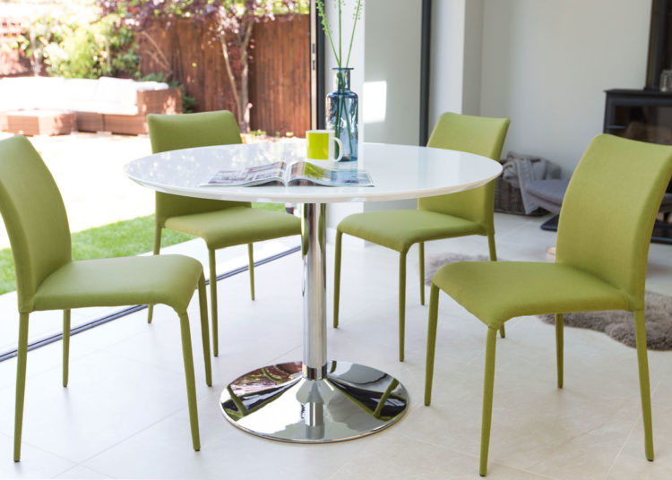 White dining table with green chairs