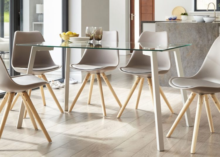 Modern glass dining table with grey chairs