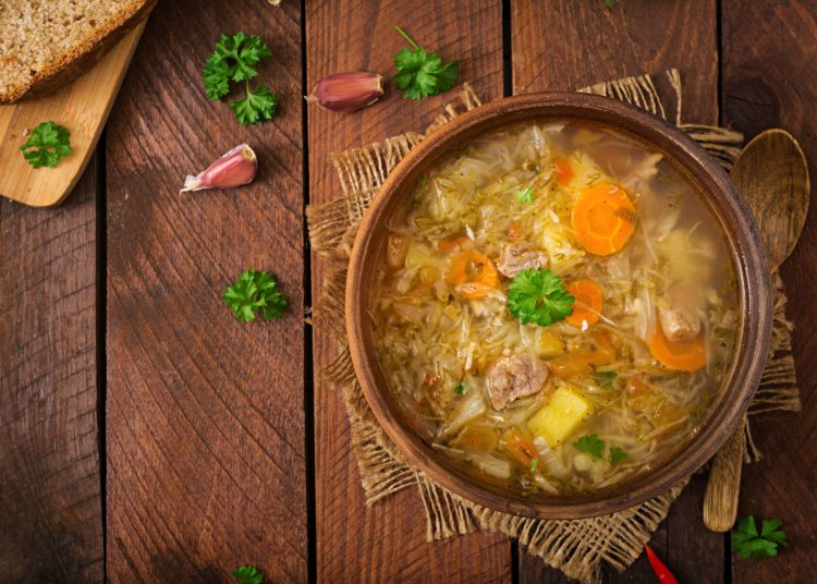 Traditional Russian soup with cabbage - sauerkraut soup. Flat lay. Top viewTraditional Russian soup with cabbage - sauerkraut soup. Flat lay. Top view