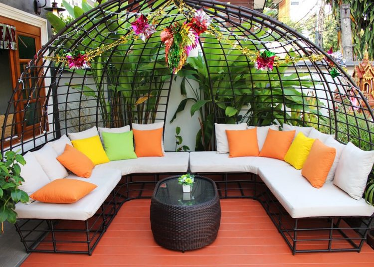 Elegant patio furniture with colorful cushions.