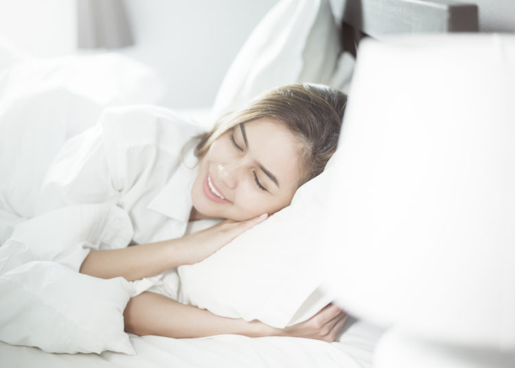 Beautiful woman sleeping on bed