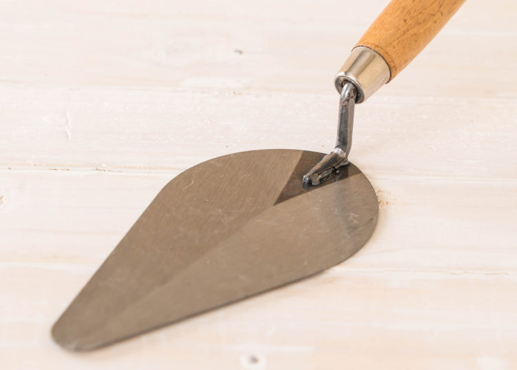 Trowel the mortar on wood background