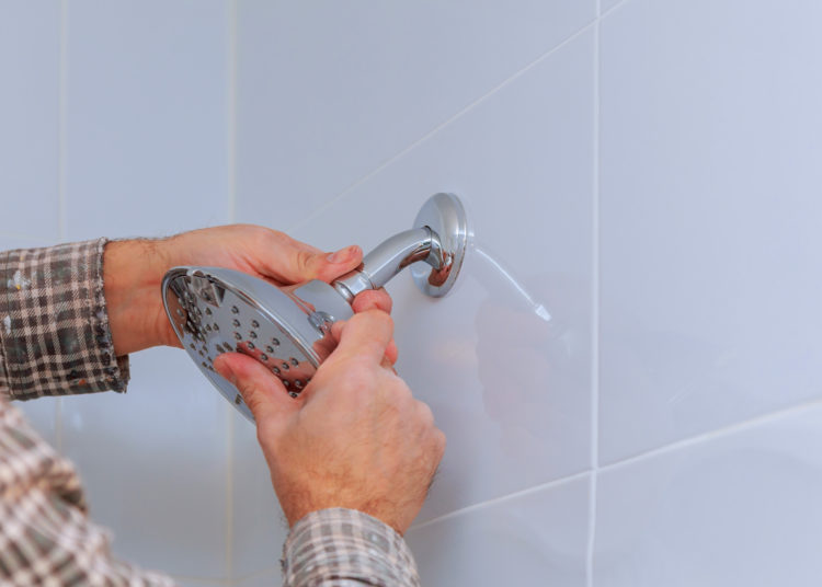 Replacing the plumbing in the bathroom mounted shower holder with height adjustable a shower head.
